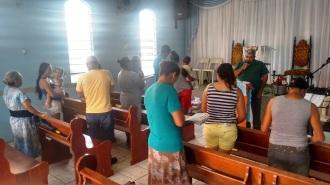 Luiz pregando